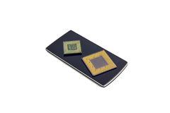Black Smart Phone With Two Computer Processor Chips Stock Photography