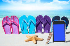 Black smartphone on the beach Royalty Free Stock Photo