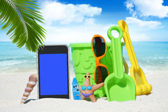 Black Smartphone and Beach Toys Royalty Free Stock Photos