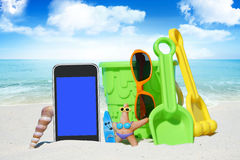 Black Smartphone and Beach Toys Royalty Free Stock Images