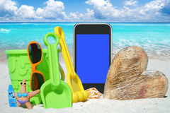 Black Smartphone and Beach Toys Royalty Free Stock Image