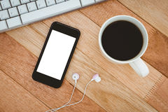 Black smartphone with cup of coffee Stock Images