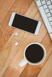 Black smartphone with cup of coffee Stock Photography