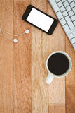 Black smartphone with cup of coffee Stock Image