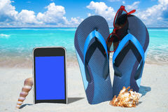 Black Smartphone and Flip Flops Royalty Free Stock Photos
