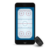 Black smartphone with ice hockey puck and field on the screen. Royalty Free Stock Photo