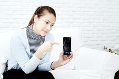 The broken mobile phone is in the hands of women. royalty free stock photo