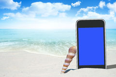 Black Smartphone and Seashell Stock Images