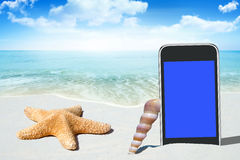 Black Smartphone and Seashells Royalty Free Stock Photos
