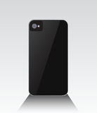 Black smartphone standing with lens Stock Photo