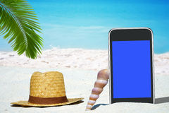 Black Smartphone and Straw hat Royalty Free Stock Photography