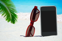 Black Smartphone and Sunglasses Stock Image