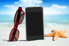 Black Smartphone and Sunglasses Royalty Free Stock Photos