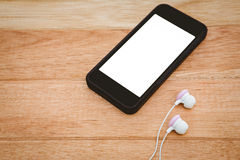 Black smartphone with white headphones Stock Photography