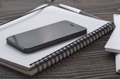 Black smartphone in the workplace Stock Images