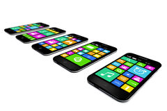 Black smartphones with a variety of software applications. Royalty Free Stock Image