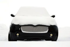 Black Smiling Minicar Under Snow Royalty Free Stock Photos