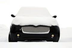 Black Smiling Minicar Under Snow Royalty Free Stock Photos