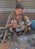 Black smith in a market szene in India Royalty Free Stock Images