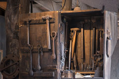 Black smith  tools spotlighted for used in a demostration Stock Photo