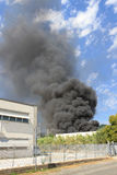 Black smoke from a blaze in a warehouse Royalty Free Stock Images