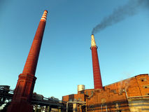 Black smoke coming up from the  brick chimney Stock Image