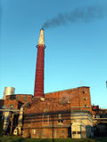 Black smoke coming up from the  brick chimney Royalty Free Stock Images