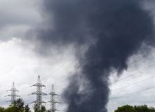 Black smoke over an industrial area Stock Photo