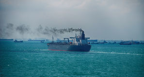 Black Smoke from Ship Sailing on the High Sea Royalty Free Stock Photos