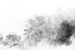 Black smoke on white background Royalty Free Stock Photos