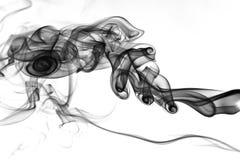 Black smoke on white background Royalty Free Stock Image