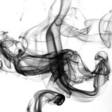 Black smoke on white background royalty free stock photography