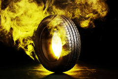 Black smoked burning tire Royalty Free Stock Photo