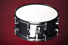 Black Snare Drum Isolated On Red Stock Image