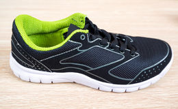 Black sneaker with green trim Royalty Free Stock Photography