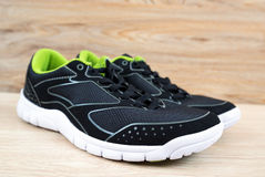 Black sneaker with green trim Stock Image