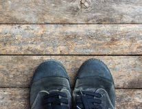 Black sneakers from an aerial view on wooden floors. Royalty Free Stock Photo