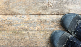 Black sneakers from an aerial view on wooden. Top view. Royalty Free Stock Image