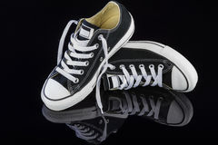 Black sneakers Stock Images
