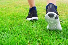 Black sneakers in grass stock image