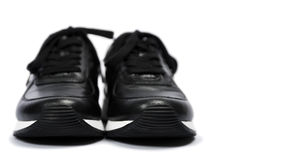 Black sneakers Stock Image