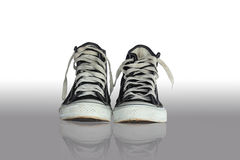 Black sneakers. Old dirty sneakers  black on a white background Royalty Free Stock Photos