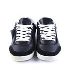 Black sneakers with white laces. Royalty Free Stock Image