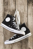 Black sneakers on wooden Stock Images