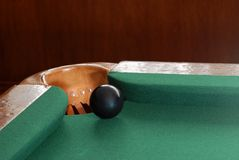 Black snooker ball by corner pocket Stock Photos