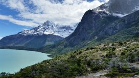 Snow-capped granite peaks and turqouise lake in Torres del Paine National Park, Patagonia Chile. Black snow-capped peaks and turqouise lake in Torres del Paine stock images