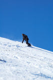 Black snowboarder. And blue sky Royalty Free Stock Image