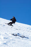 Black snowboarder. And blue sky Royalty Free Stock Photo