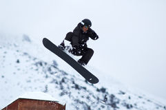 Black snowboarder fly. Black snowboarder Royalty Free Stock Photography