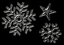 Black snowflakes Stock Photos